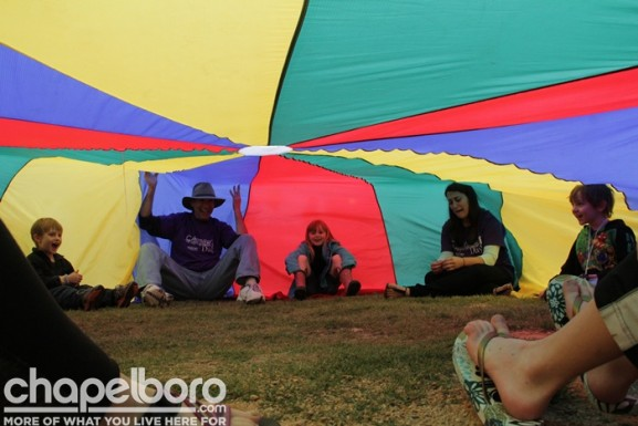 Having fun telling stories under the parachute!