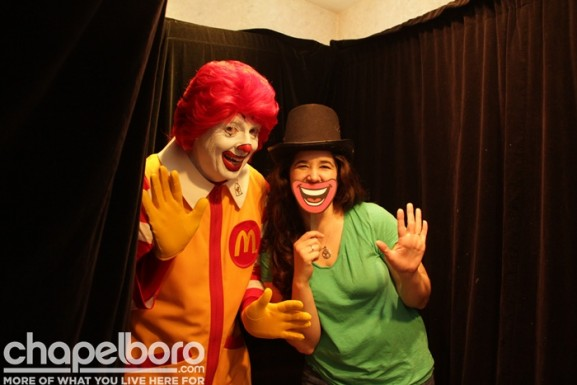 Ronald McDonald and Elizabeth Hullender check out the photobooth!