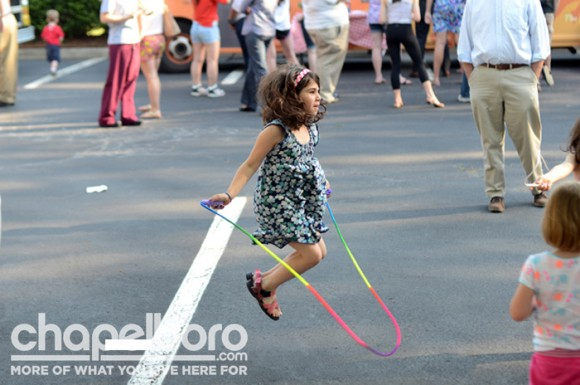 Miriam Weiler jumps rope while waiting for her parents to bring back something good to eat.