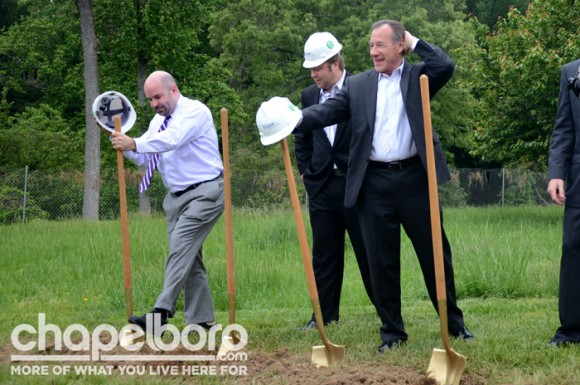 Aaron Nelson, Chris King and Michael King break ground with golden shovels and hard hats.