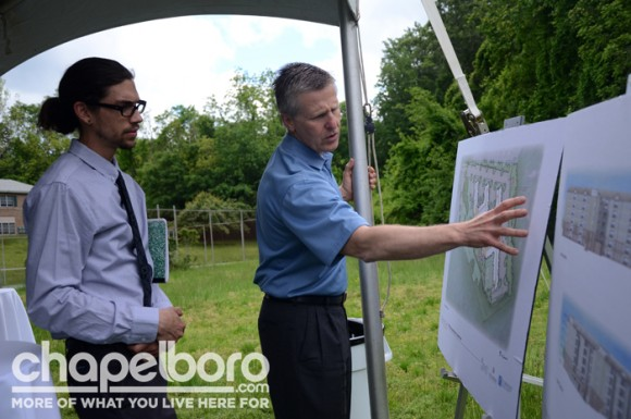 Joe Blake shows Brett Harbour, the team's public artist whose specialty is sculpture, renderings of the future property.