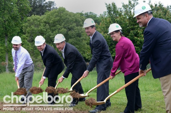 Aaron Nelson, Chris King, Michael King, Loren King, Meg McGurk and Travis Vencel break ground for the new site of Trinitas Bicycle Community in Chapel Hill.
