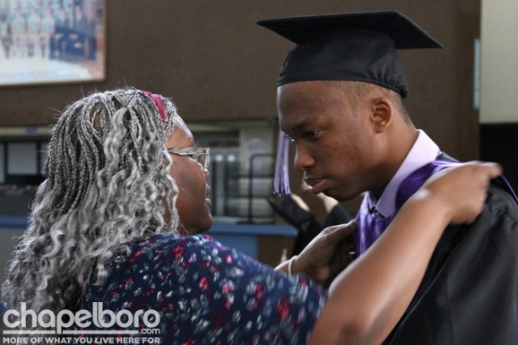 Monica Tsotetsi helps Neo Tsotetsi with his cap and gown