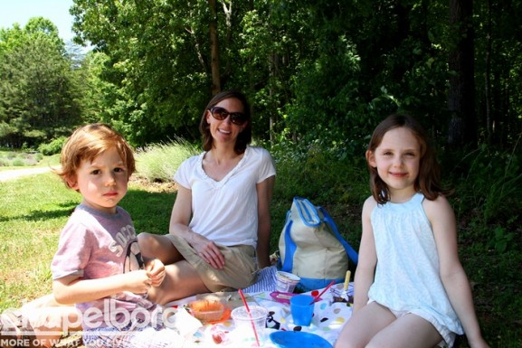Anders Brennan, Kirstin Miller and Annika Brigitta enjoy a picnic at the farm