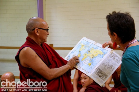Lobzang Chetan and Rinah Rachel Galper show the children where Tibet is on the map