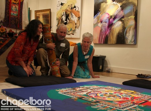 Judith Brooks, Chris Carter and Jane Cairnes admire the Mandala artwork