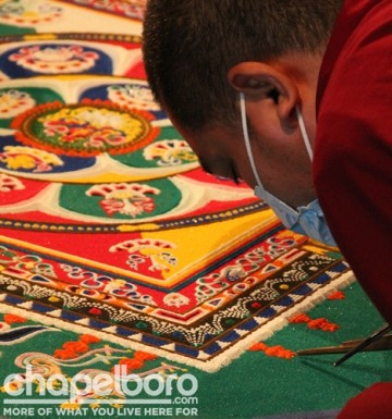 Jamphel Gyatso at work on the Mandala