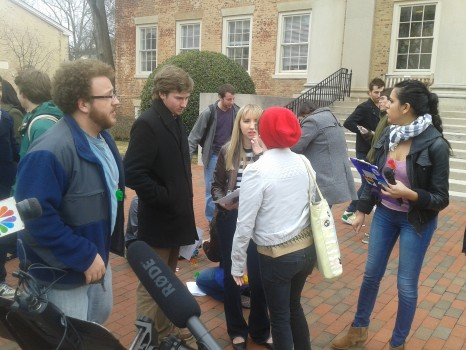 Landen Gambill at a rally in front of the South Building on UNC's campus.