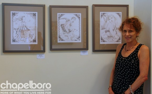 Sudie Rakusin poses with some of her beautiful pen and ink drawings