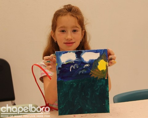 Natalie shows off her artwork