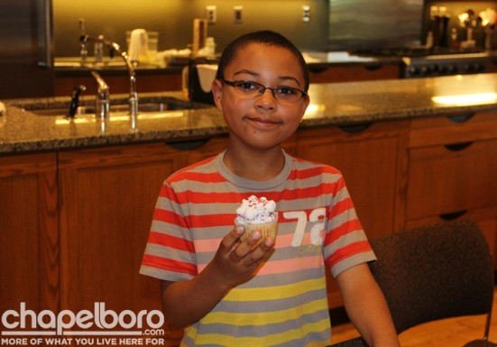 Upstairs at Southern Season, Jacob George decorated his own cupcake!