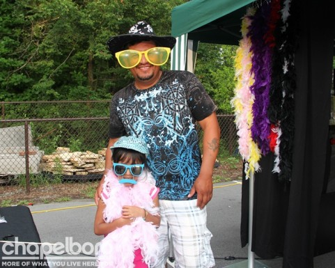 Juan Sanchez and Rebecca Sanchez have a little fun at the Memory Makers photo booth