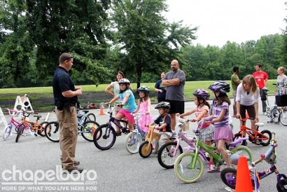 Officer Joey Glenn talks to the kids about bike safety