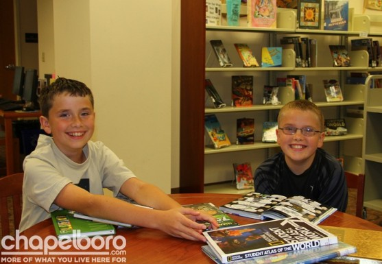 Samuel Jacob and Noah Alexander having fun at the library