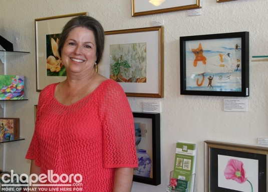 Artist Brenda Baldwin-Scott with her beautiful paintings