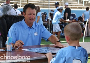 Coach Larry Fedora takes time to talk to a young fan