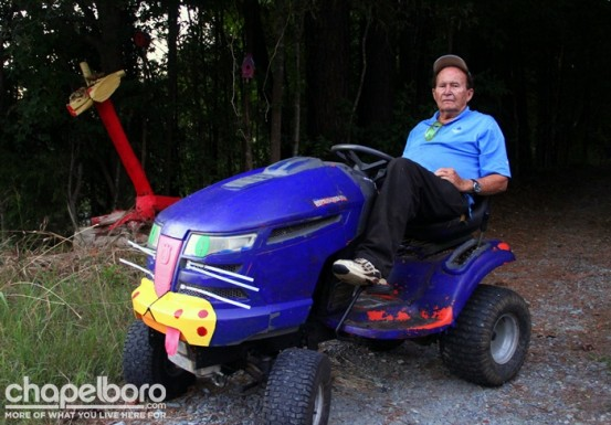 Clyde Jones enjoys the concert from his customized lawn mower!
