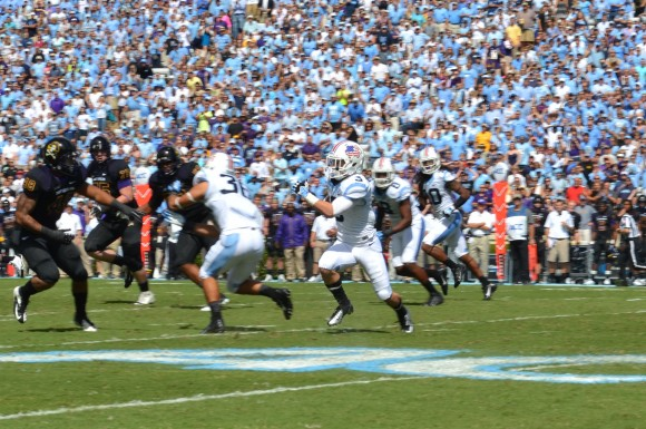 Ryan Switzer returns a first-half punt.