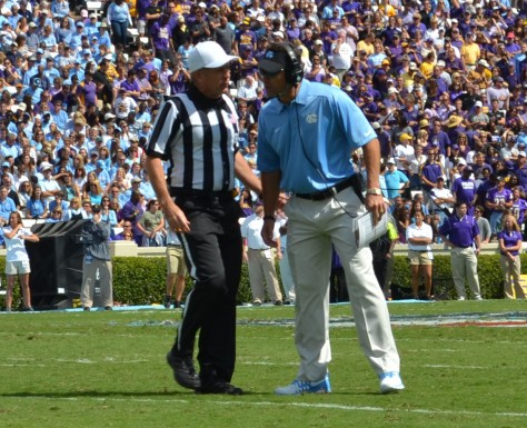 Coach Larry Fedora asks for an explanation.
