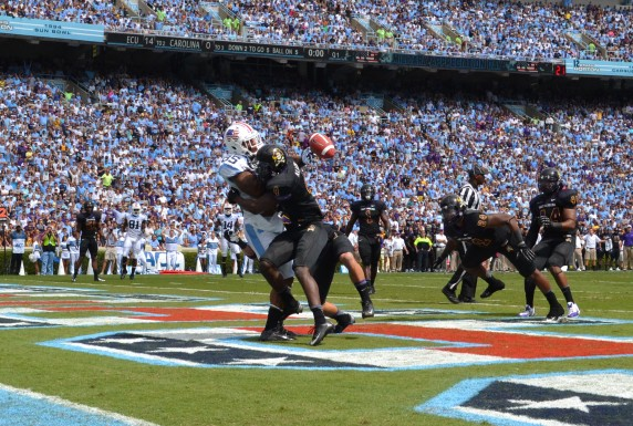 ECU's Detric Allen manages to pop the ball loose from Eric Ebron.