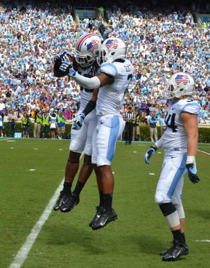 Jeff Schoettmer and Tim Scott help celebrate Tre Boston's interception.