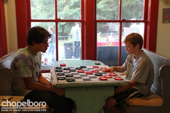 Inside, Jayden Smith and Avery Michaels played a friendly game of chess.