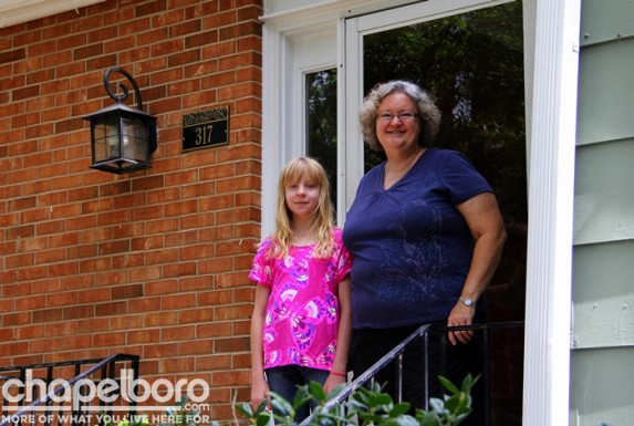 Elizabeth Prytherch and Susan Prytherch stand on the front porch of their newly renovated home!