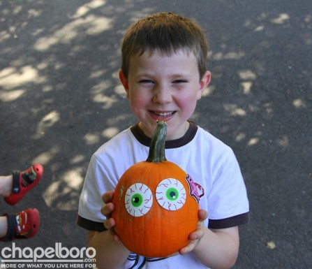 Noah Noblin with his pumpkin from the pumpkin patch