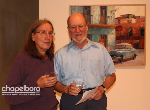 Pat Carstensen and Ed Harrison in front of their favorite painting