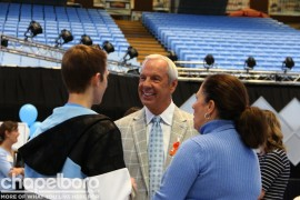 Roy Williams talks with some fans at the Fast Break Breakfast