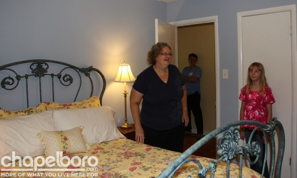 Susan Prytherch gets her first look at the newly painted master bedroom!