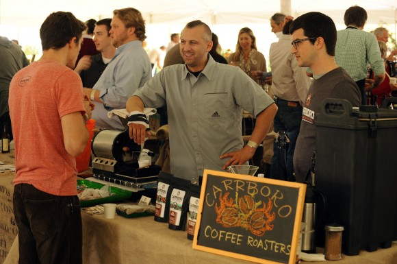 Scott Canary with Open Eye Cafe and Carrboro Roasters attracted hundreds of people to his booth