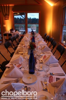 The dinner was set perfectly inside the Farm House at the Riding Center .