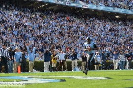 Wearing #2 in honor of Bryn Renner, UNC's Marquise Williams catches a touchdown pass in the first quarter.