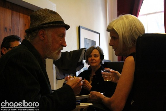 Allan Gurganus and Betsy Levitas talk backstage in the green room